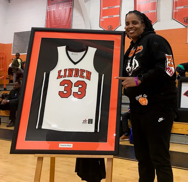 Former Linden High School basketball star Tamecka Dixon with her retired No. 33 jersey, which was retired at a ceremony on Feb. 24, 2020.