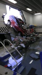 A car drove through a wall and into the swimming pool at the Somerville YMCA on Wednesday