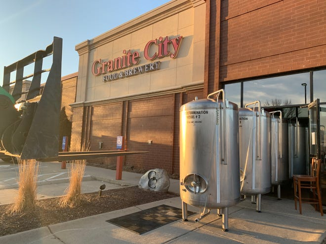 Empty brewery vessels sat outside the Granite City Food and Brewery in Clive, which closed in early March.