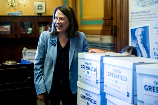Theresa Greenfield, candidate for U.S. Senate, smiles standing next to the boxes of signatures just submitted to get on the ballot for the 2020 Senate race, on Wednesday, March 4, 2020, at the Iowa State Capitol in Des Moines.
