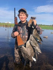 Drew Nelson of Winterset proudly shows off the water fowl he shot during a hunt.  Nelson, 15, had dreams of becoming a professional hunting guide. He died Feb. 21, 2020, in a car crash.