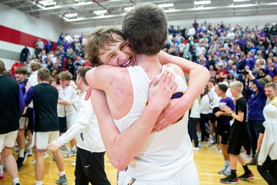 Waukee's Tucker DeVries hugs teammate Payton Sandfort after winning the Waukee vs. West Des Moines Valley boys substate final game on Tuesday, March 3, 2020, in the Dallas Center-Grimes High School gym.