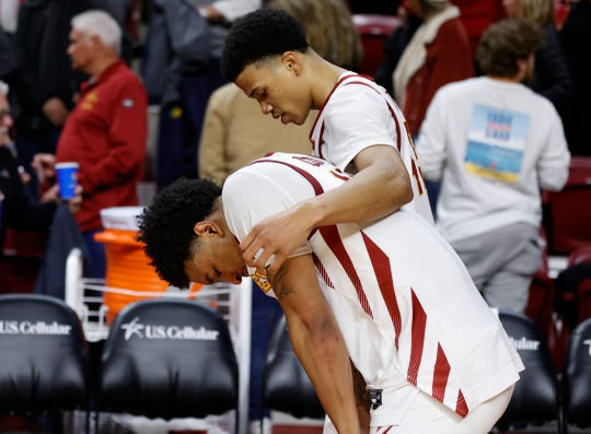 Iowa State guard Rasir Bolton, top, consoles guard Prentiss Nixon after the team's 77-71 loss to West Virginia in an NCAA college basketball game Tuesday, March 3, 2020, in Ames, Iowa.