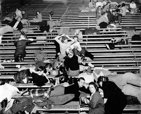 State basketball tournament fans settle on to the bleachers to try to get some sleep in March 1959.