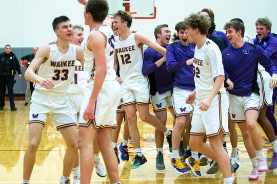 Waukee celebrates winning the Waukee vs. West Des Moines Valley boys substate final game on Tuesday, March 3, 2020, in the Dallas Center-Grimes High School gym.