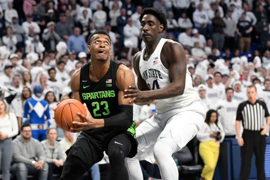 Michigan State's Xavier Tillman Sr. tries to get past Penn State's Mike Watkins during the first half Tuesday, March 3, 2020, in University Park, Pa.