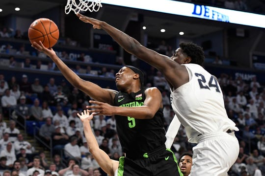 Michigan State's Cassius Winston shoots as Penn State's Mike Watkins defends during the first half Tuesday, March 3, 2020, in University Park, Pa.