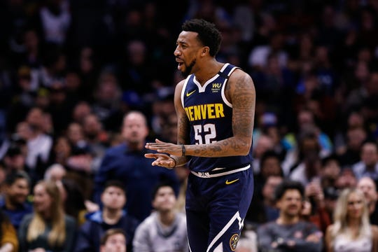 Denver Nuggets guard Jordan McRae reacts after a play against the San Antonio Spurs at the Pepsi Center in Denver, Feb. 10, 2020.