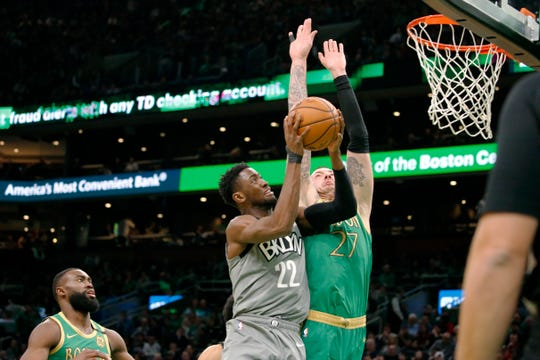 Brooklyn Nets guard Caris LeVert drives to the basket against Boston Celtics' Daniel Theis during the first half Tuesday, March 3, 2020, in Boston.