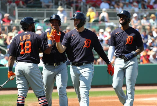 Tigers first baseman C.J. Cron is congratulated by teammates as he hits a 3-run home run during the first inning against the Boston Red Sox on Wednesday, March 4, 2020, at JetBlue Park in Fort Myers, Florida.
