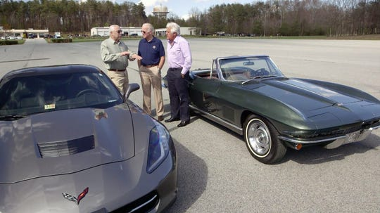 Colin Powell, Joe Biden and Jay Leno, from left, with Biden's Corvette.