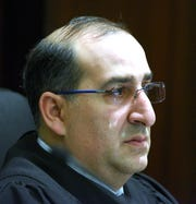 Michigan Supreme Court  Justice David F. Viviano hears a case.