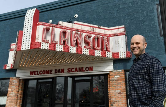 "Clawson-born filmmaker Dan Scanlon poses in front of Three Cats Cafe in Clawson where his name has been put on the marquis.  Scanlon is the director of the new Pixar movie ""Onward"" and was in town for a special screening to benefit the Assistance League of Southeastern Michigan."