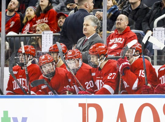 Head coach MIke Schafer watches during the Cornell men's hockey team's 2-0 victory over Boston University in the biennial Red Hot Hockey event on Nov. 30, 2019 at Madison Square Garden in New York.
