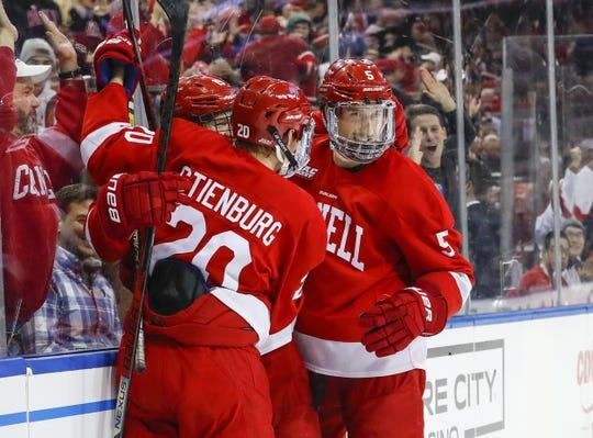 From left, Michael Regush, Matt Stienburg and Sebastian Dirven celebrate Regush's goal during the Cornell men's hockey team's 2-0 victory over Boston University in the biennial Red Hot Hockey event on Nov. 30, 2019 at Madison Square Garden in New York.