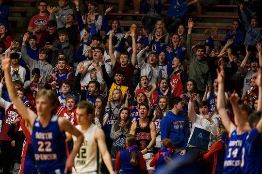 The South Spencer Rebels student section lights up after their team nets three points against the Forest Park Rangers during the Class 2A boys basketball sectional opener at Huntingburg Memorial Gymnasium in Huntingburg, Ind., Tuesday, March 3, 2020. The Rebels defeated the Rangers, 60-43.