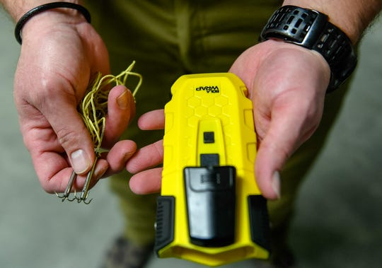 The BolaWrap 100 hand-held restraint device with one of the expended cords and attachment barbs during a demonstration for law enforcement officials at the Vanderburgh County  Sheriff's Office Wednesday, March 4, 2020.