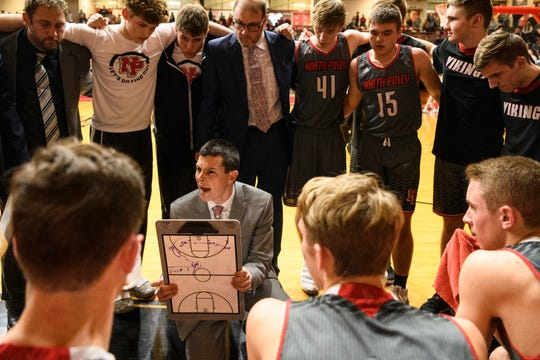 North Posey Head Coach Heath Howington talks to his team during a timeout in the fourth quarter of the Class 2A boys basketball sectional opening round against the Mater Dei Wildcats at Huntingburg Memorial Gymnasium in Huntingburg, Ind., Tuesday, March 3, 2020. The Vikings defeated the Wildcats, 66-58.