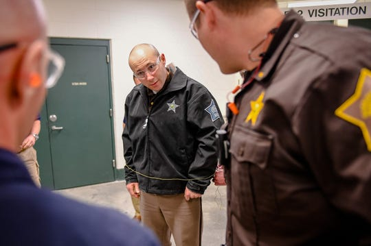 Fellow officers watch as the restraining kevlar cord is unwrapped from Lt. Matt Corn with the Vanderburgh County Sheriff's Department as representatives from BolaWrap demonstrate their BolaWrap 100 hand-held restraint device for law enforcement officials at the Vanderburgh County Sheriff's Office Wednesday, March 4, 2020.