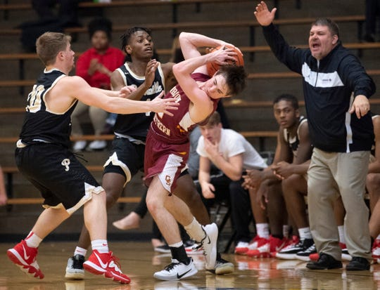 Gibson Southern's Brayden Malone (2) is pressured by Bosse's Kolten Sanford (20) and Ty'Ran Funches in the Bulldogs' 61-44 win on Tuesday night in the first round of the Class 3A Boonville Sectional.