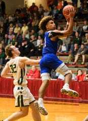 South Spencer's Jace Kelly (11) jumps around Forest Park's Simon Jacob (32) to net two points during the fourth quarter of the Class 2A boys basketball sectional opening round at Huntingburg Memorial Gymnasium in Huntingburg, Ind., Tuesday, March 3, 2020. The Rebels defeated the Rangers, 60-43.