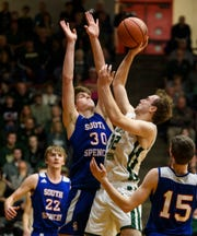 South Spencer's Holt Compton (30) blocks Forest Park's Simon Jacob (32) from the net during the Class 2A boys basketball sectional opening round at Huntingburg Memorial Gymnasium in Huntingburg, Ind., Tuesday, March 3, 2020. The Rebels defeated the Rangers, 60-43.