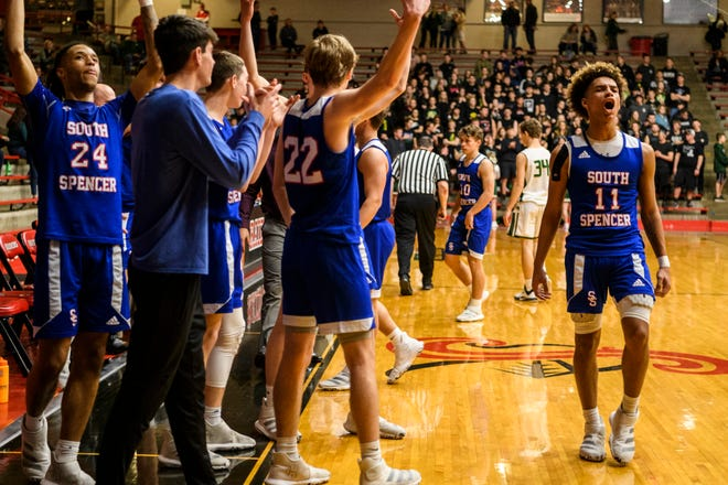 South Spencer's Jace Kelly (11) and his teammates celebrate their 60-43 victory over the Forest Park Rangers as the game clock runs out on the Class 2A boys basketball sectional opening round at Huntingburg Memorial Gymnasium in Huntingburg, Ind., Tuesday, March 3, 2020.