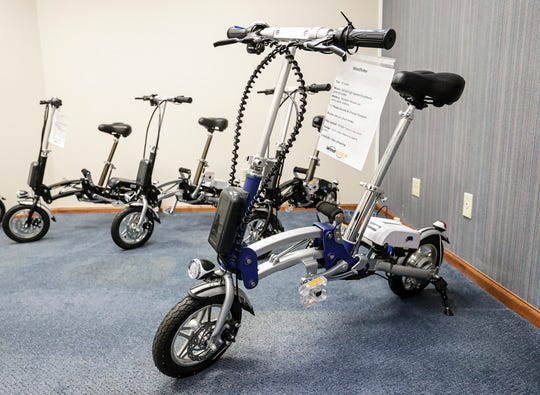 Some of the mid-sized electric bikes on display Tuesday, March 3, 2020, in the pop-up store Jus-e-wheels on Main Street in Fond du Lac, Wis.