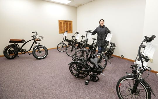 Pop-up store Jus-e-wheels owner Kristin Vanderkin-Jus stands with some of the inventory in her store Tuesday, March 3, 2020, on Main Street in Fond du Lac, Wis.