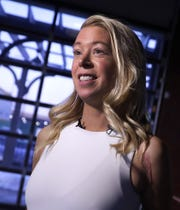 Adrianne Haslet, who lost her left foot in the 2013 Boston Marathon bombing, speaks to media before sharing her story during the Bellin Run's 2020 Kids for Running kick-off event at Green Bay Distillery on Tuesday.