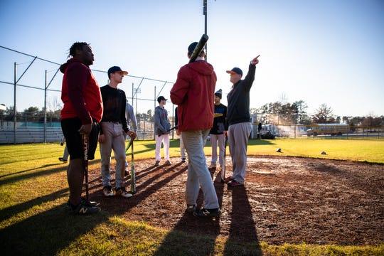 Carolina High School head coach Matthew Schuette talks to his team during practice Friday, February 21, 2020.