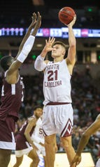 South Carolina Gamecocks forward Maik Kotsar (21) shoots over Mississippi State Bulldogs forward Abdul Ado (24) in the first half at Colonial Life Arena Tuesday night in Columbia.