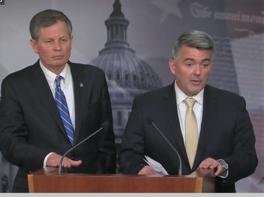 Sen. Steve Daines, R-Mont., left, and Sen. Cory Gardner, R-Colo., speak to reporters Wednesday about the Land and Water Conservation Fund.