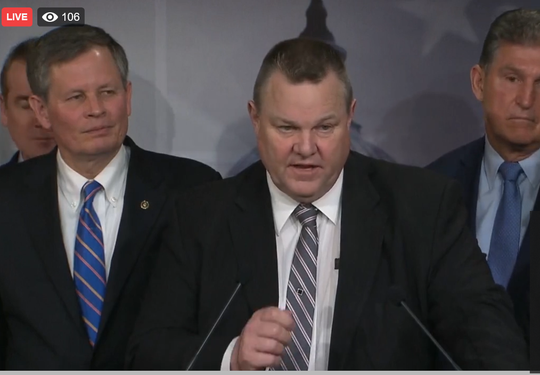 Sen. Jon Tester, D-Mont., speaks Wednesday about the Land and Water Conservation Fund as Sen. Steve Daines, left, Mont., looks on.