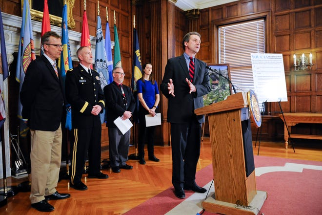 Montana Gov. Steve Bullock announces the formation of a coronavirus task force Tuesday, March 3, 2020 at the state Capitol in Helena.  (Thom Bridge/Independent Record via AP)