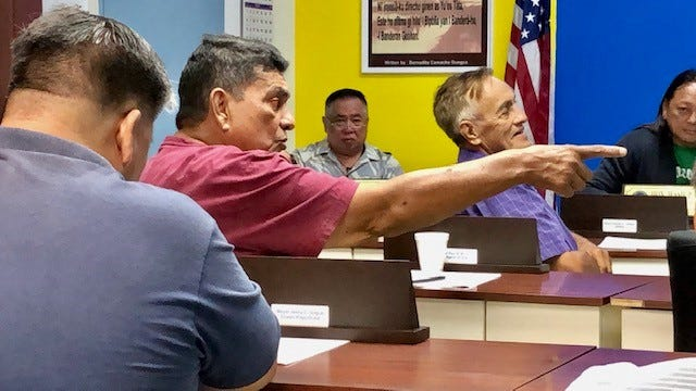 Agana Heights Paul McDonald gestures while taling about public safety concerns involving young people at a meeting of mayors on March 4.