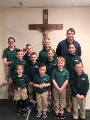 The Holy Name Cardinals of the Month for February 2020 are, front row from left, Brylee Cates, Brantley Bosler- Johnston, Madison Hester, and Conner Brown. Middle row from left, Reese Hankins, August Krampe, Lucy Cassidy,  and Brooklyn King. Back row from left, Paige Goldsberry, Jax Benton, Parker Heistand,  and Ethan Luce.