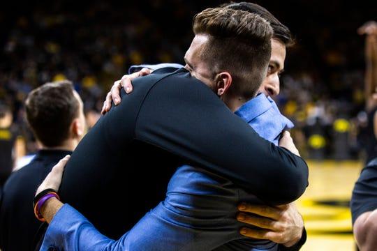 Iowa forward Ryan Kriener (15) embraces teammate guard Jordan Bohannon before a NCAA Big Ten Conference men's basketball game against Purdue on senior night, Tuesday, March 3, 2020, at Carver-Hawkeye Arena in Iowa City, Iowa.