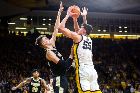 Luka Garza averaged 23.9 points per game this season for the Hawkeyes on his way to becoming the school's first first-team consensus all-American in men's hoops since 1952.