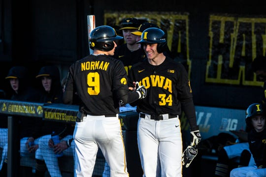 Iowa's Ben Norman, left, greets teammate Austin Martin during a NCAA non conference baseball game, Tuesday, March 3, 2020, at Duane Banks Field in Iowa City, Iowa.