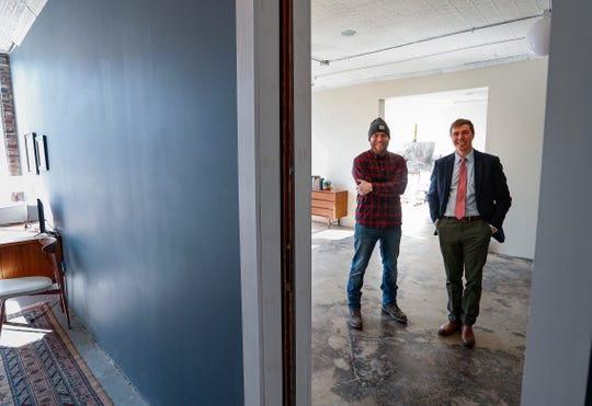 Justin Vining, left, shares a space for his art gallery with his brother, attorney Nathan Vining, right, on 2600 block of E. 10th St., Indianapolis, Wednesday, March 4, 2020. Nathan practices law in the office on the east side of the building and Justin has his paintings and works in the space on the far west side of the building.