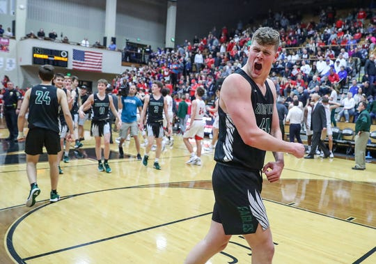 Zionsville Eagles Gunnar Vannatta (44) celebrates the team's sectional win over Fishers at Noblesville High School on Tuesday, March. 3, 2020. Zionsville's Jackson Hughes (21) scored two points in the final seconds of the game to clinch the win, 23-21.