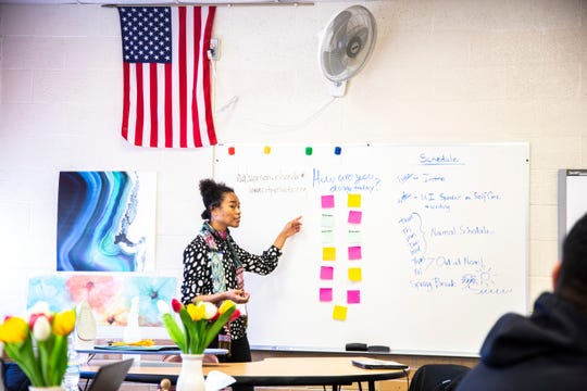 Emily Spencer, associate director of the Iowa Youth Writing Project, lays out notes written by students during an introduction activity while visiting a class, Wednesday, March 4, 2020, at Tate High School in Iowa City, Iowa.