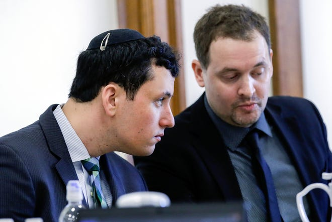 David Weltman (left) listens to his attorney Christopher Foster during his trial on Wednesday, March 4, 2020 at the Johnson County Courthouse in Iowa City, Iowa. Weltman is accused of sexually abusing a then 9-year-old boy during a Hebrew lesson at Iowa Hillel, where Weltman was the director of the student Jewish organization.
