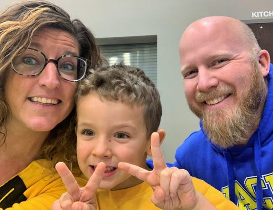 """A selfie shows the Ortmann family of North Liberty today, with Calvin preparing to enter kindergarten in the fall. Libby and Andy are active in Chelsey's Dream Foundation, which was founded by an Anamosa couple who were touched by the Ortmann's """"adoption through Facebook"""" story."""
