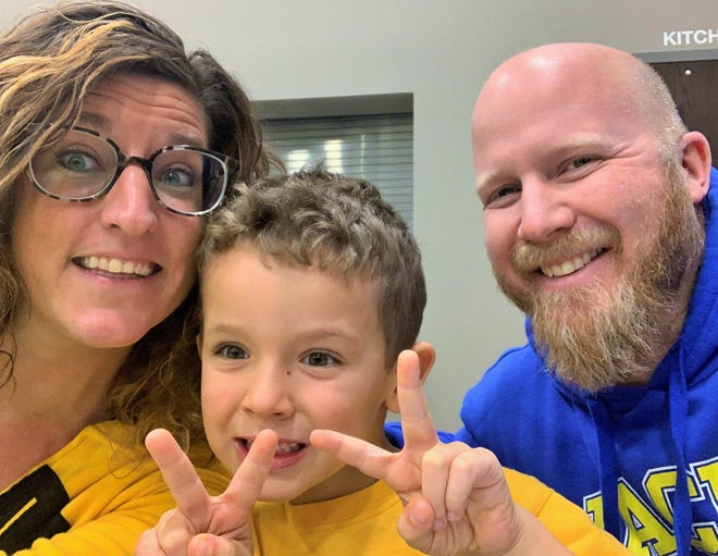 "A selfie shows the Ortmann family of North Liberty today, with Calvin preparing to enter kindergarten in the fall. Libby and Andy are active in Chelsey's Dream Foundation, which was founded by an Anamosa couple who were touched by the Ortmann's ""adoption through Facebook"" story."