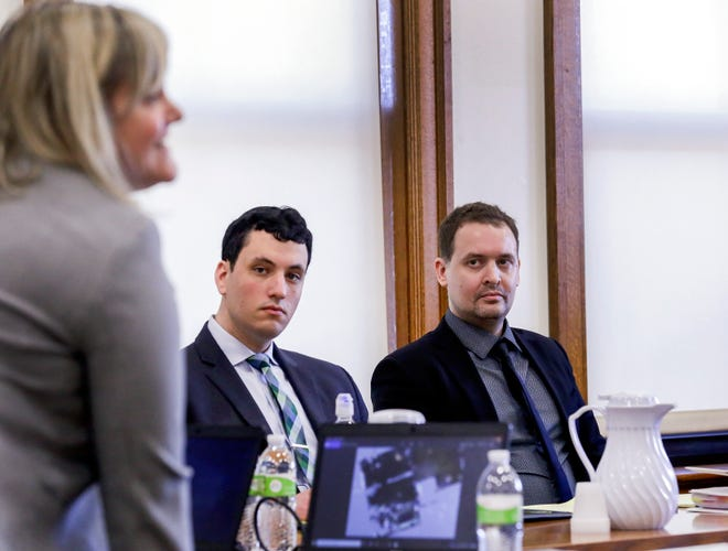 Defense attorney Christopher Foster (right) and defendant David Weltman (center) listen to assistant Johnson County attorney Rachel Zimmermann-Smith as she gives the state's opening statement during Weltman's trial on Wednesday, March 4, 2020 at the Johnson County Courthouse in Iowa City, Iowa. Weltman is accused of sexually abusing a then 9-year-old boy during a Hebrew lesson at Iowa Hillel, where Weltman was the director of the student Jewish organization.