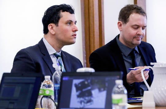 David Weltman (left) listens along with his attorney Christopher Foster to testimony from an Iowa City police detective who investigated during his trial on Wednesday, March 4, 2020 at the Johnson County Courthouse in Iowa City, Iowa. Weltman is accused of sexually abusing a then 9-year-old boy during a Hebrew lesson at Iowa Hillel, where Weltman was the director of the student Jewish organization.