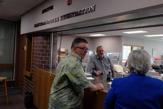 Johnson County Auditor Travis Weipert, center, is concerned about the labor costs associated with mailing absentee ballots to all registered voters. Pictured, Weipert overseeing staff as they accept affadavits of candidacy on March 4, 2020.