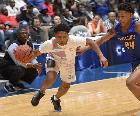 Callaway's Daeshun Ruffin (24) drives against Wingfield's Ziekell Jaqwone Curry (24) in the semifinals of the MHSAA State Basketball Tournament on Tuesday, March 3, 2020, at the Mississippi Coliseum in Jackson, Miss.